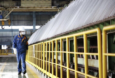 Worker in production plant